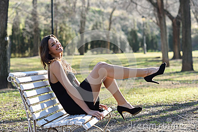 Funny Female Model Of Fashion With High Heels Sitting On A