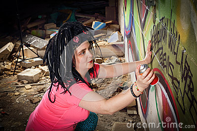 Graffiti Artist Spraying Wall in Derelict Building