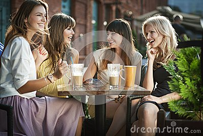 Group Of Young Women Drinking Coffee Royalty Free Stock