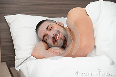 Happy Man Waking Up In His Bedroom Stock Photo Image