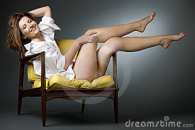 Happy Mature Woman Relaxing On Chair Stock Images  Image