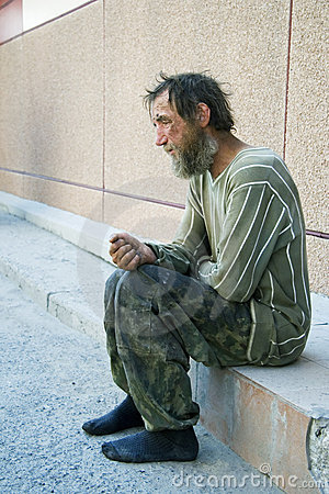 Sad homeless man in depression