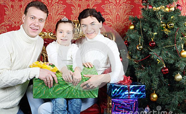 Husband Wife And Daugther Hold Gift And Smile Royalty