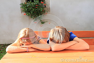 Kids Sitting Behind Wooden Table Stock Photo  Image 44698483