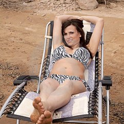 Woman Sitting In Chair Portable Tattoo Lawnchair Front View Royalty Free Stock Photography - Image: 14568427