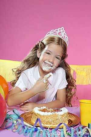 Little Blond Girl Eating Birthday Cake With Hands Royalty