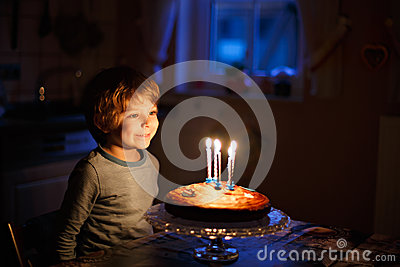 Little Kid Boy Celebrating His Birthday And Blowing Candles On Cake Stock Photo Image 84569265
