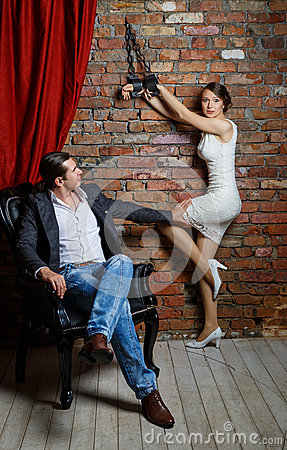 Man In A Chair And The Woman In Shackles In The Room Stock