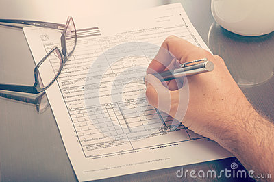 Man Filling An Health Insurance Claim Form Stock Photo