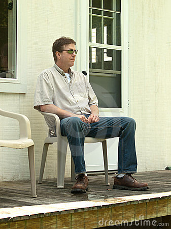 Man Sitting On A Porch Stock Images  Image 24205544