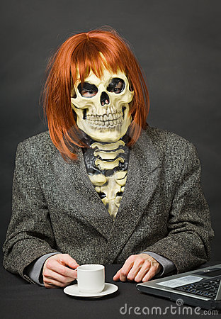 Man Skeleton With Red Hair Drinking Coffee Stock Image
