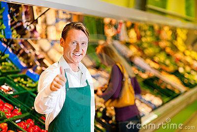 Man In Supermarket As Shop Assistant Stock Photo  Image 18941140