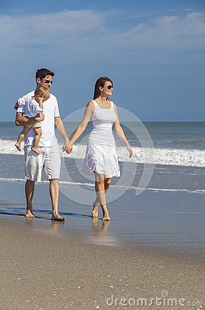 Man Woman Couple Baby Child Walking On Beach Stock Photo