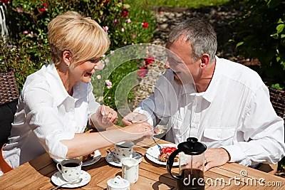Mature couple having coffee on porch Stock Photos - Image: 12745943