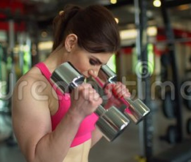 Muscular Athlete Woman In A Pink Top Working Out In The Gym Lifting Weights Fitness Girl Exercising In The Gym With Stock Footage Video Of Person