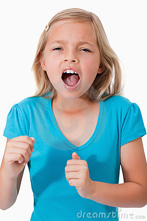 Portrait Of A Young Girl Screaming Royalty Free Stock