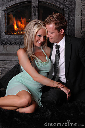 Romantic Couple Fireplace Flirty Stock Photography - Image