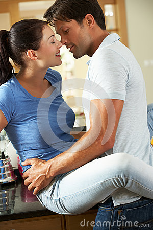 Romantic Couple Hugging In Kitchen Royalty Free Stock