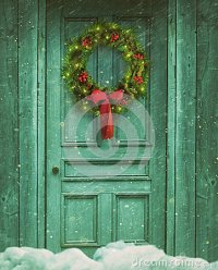 Rustic Barn Door With Christmas Wreath Stock Photo