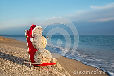 Sandy Snowman Sunbathing In Beach Lounge Holiday Concept