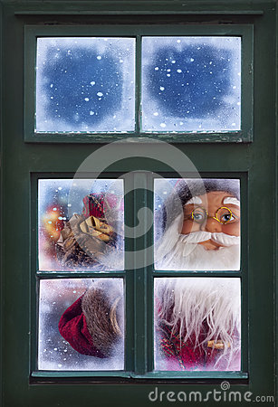Santa Claus Looking Through A Window Royalty Free Stock