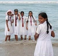 Schoolgirls In Uniform Playing On The Beach Editorial ...
