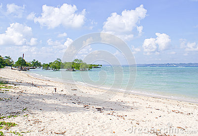 Serene blue landscape with white sand