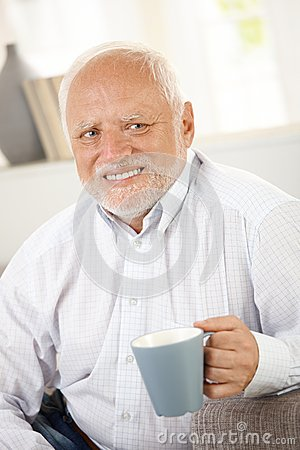 Smiling Old Man Having Coffee Royalty Free Stock