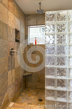 Spa Bathroom Shower Area With Stone Tile And Glass Block