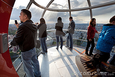 Tourists in the London eye cabin