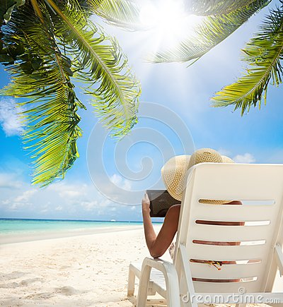 Relax On The Beach And Tablet Computer Stock Images