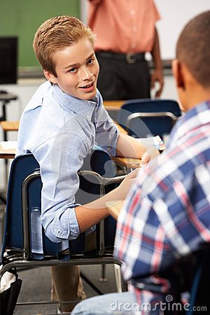 Two Male Pupils Talking In Class Stock Image  Image 30848911
