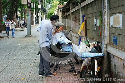 Vietnamese Open Air Barber Shop On Pavement Editorial