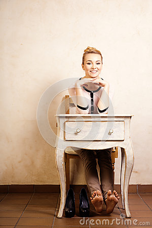 Vintage Style Barefoot Girl Sitting At Retro Desk Stock
