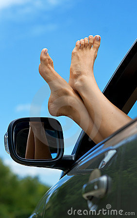 Woman Feet Out Of Car Window Royalty Free Stock Photos