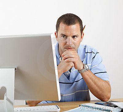 Worried Man At Desk And Computer Paying Bills Stock Image - Image: 14402711