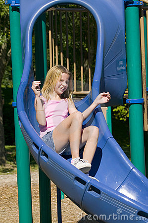 Young Girl Playing On A Slide At The Park Royalty Free Stock Photography  Image 1130577