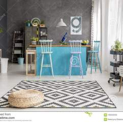 Small Kitchen Rugs Pantry For 有蒲团的宽敞餐厅库存照片 图片包括有地毯 投反对票 现代 金属 平面 在被仿造的地毯的蒲团在与蓝色凳子 植物和海报的宽敞餐厅内部在灰色墙壁上