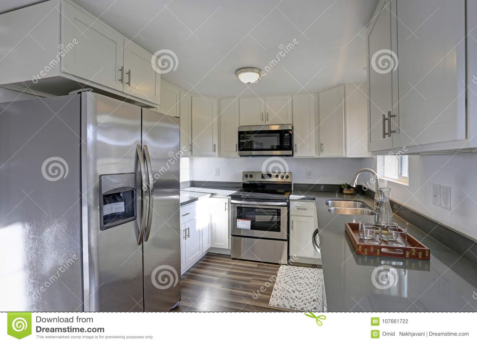 compact kitchens free standing kitchen shelves 点燃被填装的家庭内部特点小紧凑厨房库存照片 图片包括有设计 拱道 点燃有白色内阁和现代不锈钢装置的被填装的家庭内部特点小紧凑厨房