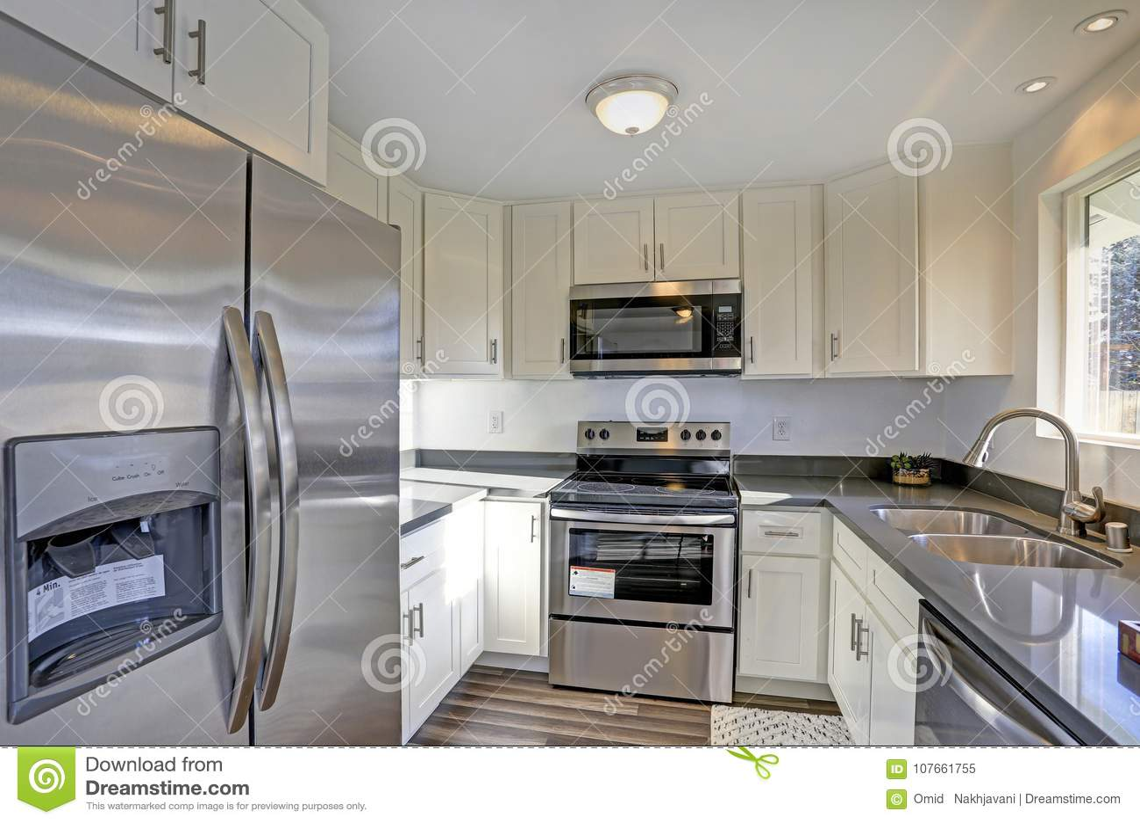 compact kitchens kitchen appliance suite 点燃被填装的家庭内部特点小紧凑厨房库存图片 图片包括有厨房 火炉 点燃有白色内阁和现代不锈钢装置的被填装的家庭内部特点小紧凑厨房