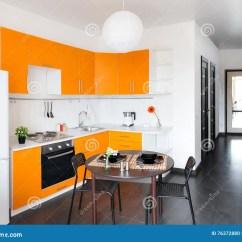 Industrial Kitchen Stools Bbq Outdoor Kits 现代橙色厨房库存照片 图片包括有豪华 凳子 当代 灌肠器 水槽 任何 有白色墙壁的当代厨房