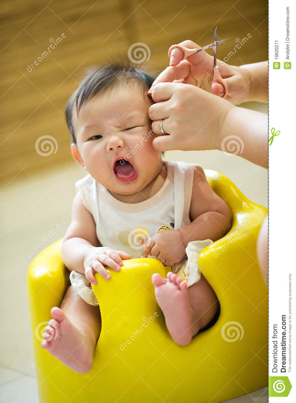 4 Month Old Asian Baby Girl Having A Haircut Stock Image