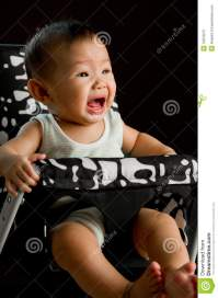 6 Month Old Asian Baby Girl Crying In High Chair Royalty ...