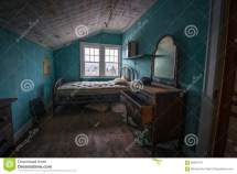 Abandoned Room With Phone And Dresser Stock
