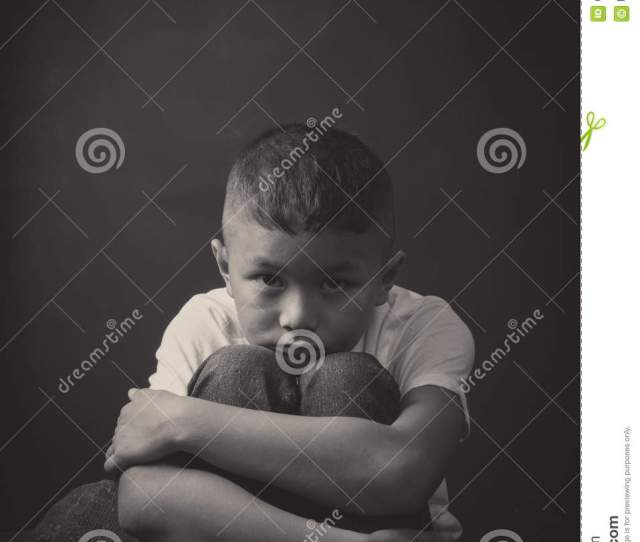 Scared And Alone Young Asian Child Who Is At High Risk Of Being Bullied Trafficked And Abused