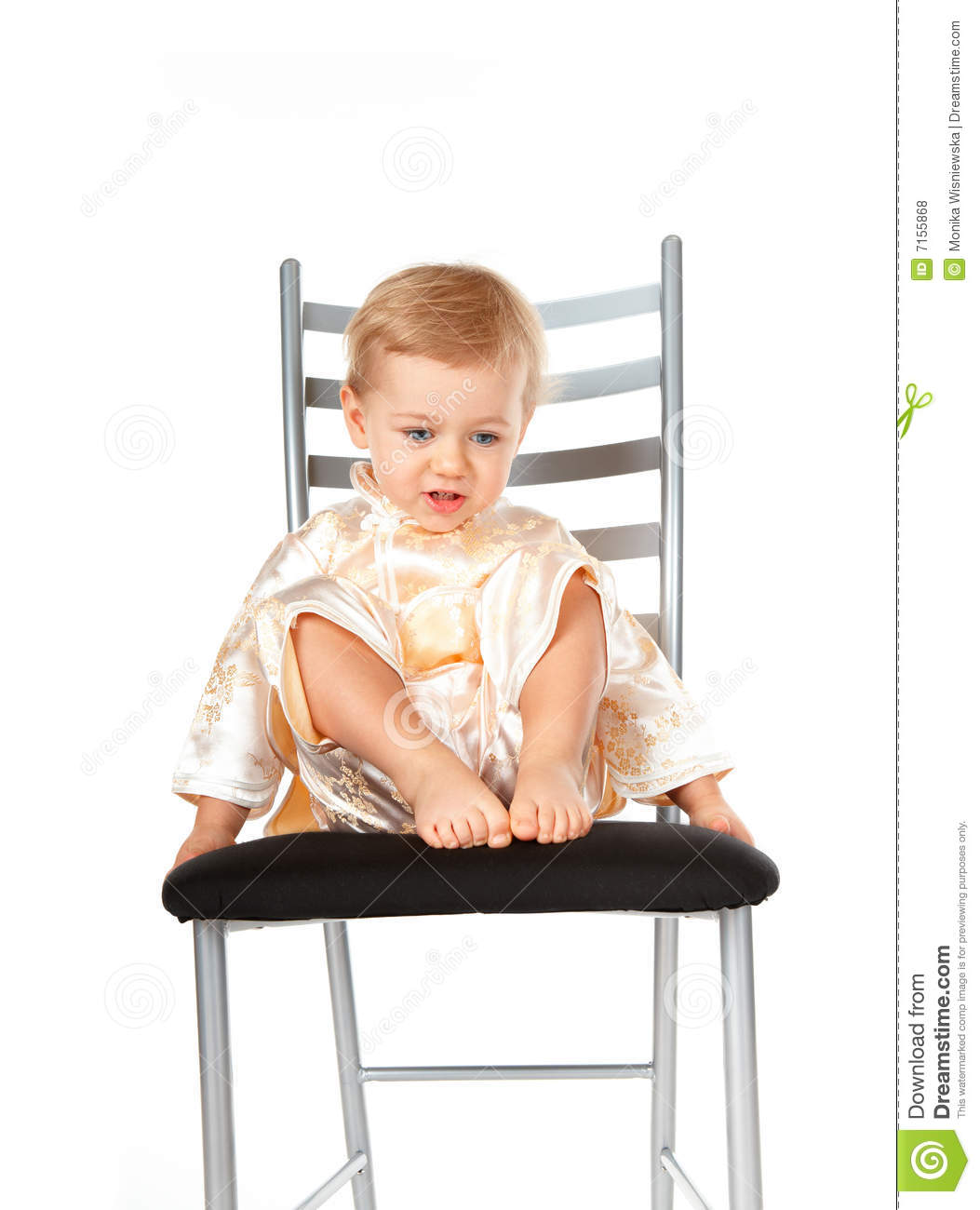 baby girl chair child s desk uk adorable sitting on a royalty free stock