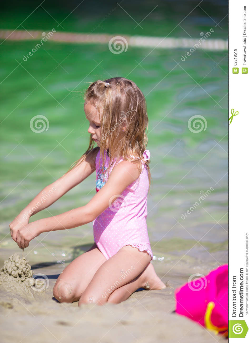 Adorable Little Girl Playing With Beach Toys Stock Photo  Image 62818519