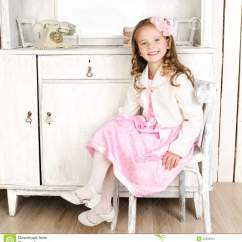 Little Girls Chairs Paula Deen Dining Adorable Girl Sitting On Chair Stock Photo Image