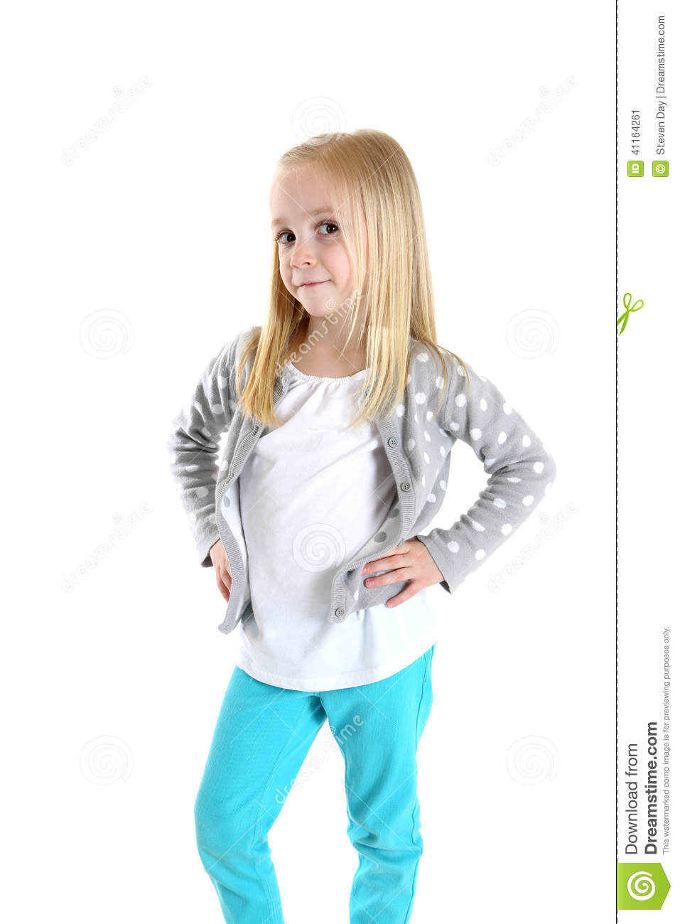 Adorable Young Girl Standing With Her Hands On Her Hips