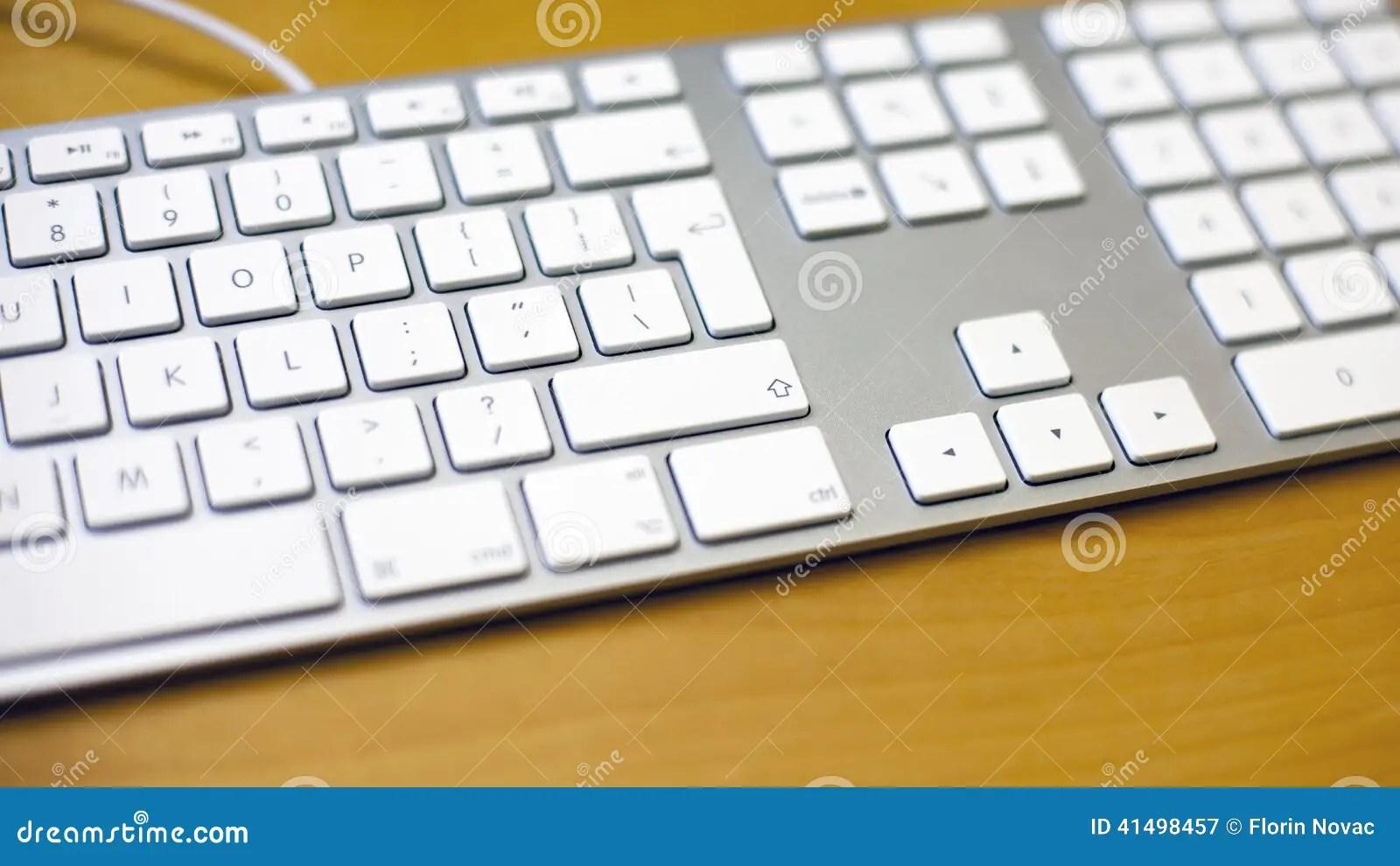 Aluminum Blank Keyboard On Wooden Desk Stock Image